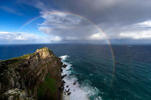 stunning-rainbow-links-the-indian-and-atlantic-oceans-south-africa-photo-by-chris-mclennan2